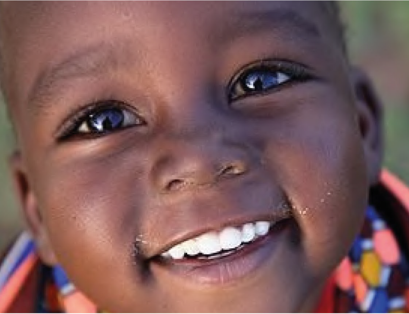 Child smiling. By supporting KET's children's charity in Africa, you are making a difference to their futures